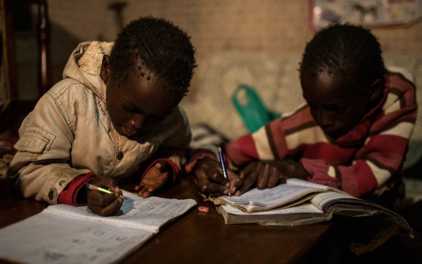 The Saltaban children spend more time on their homework because there's no kerosene smoke to get in their eyes.